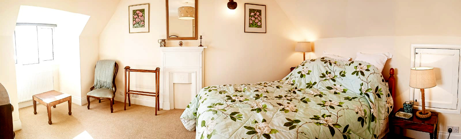 King size double bed in the large bedroom